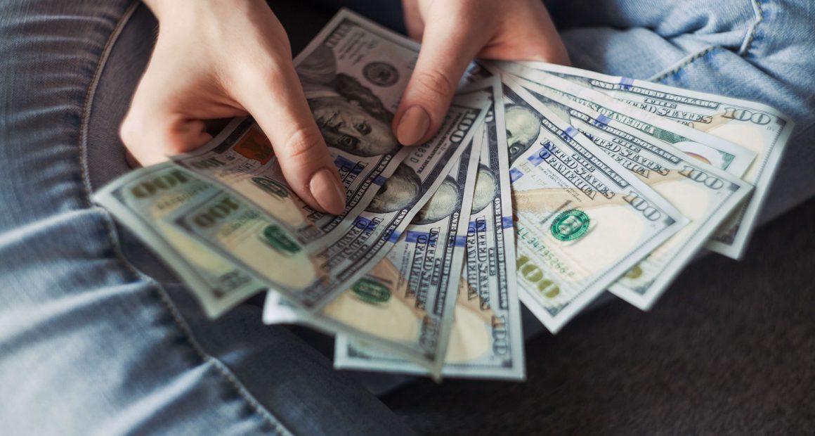 100 dollar bills fanned out