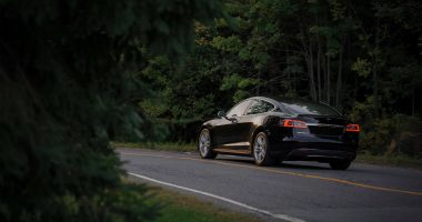 Tesla Model S driving away