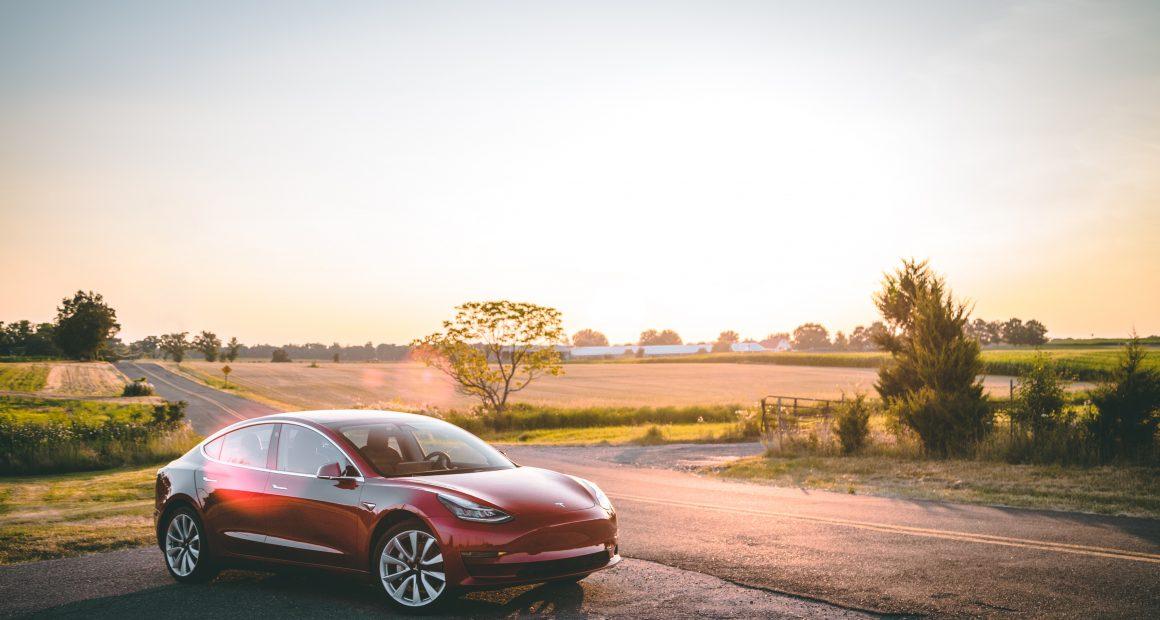Tesla Model 3 in a sunset