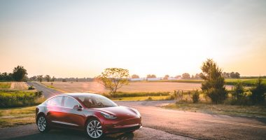 Tesla Model 3 in a sunset