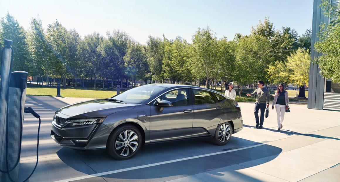 Honda Clarity charging in a park