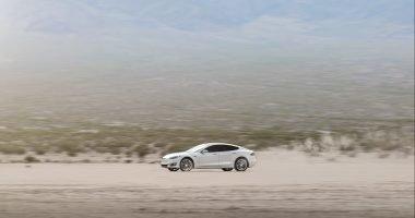 White Tesla Model S in sand