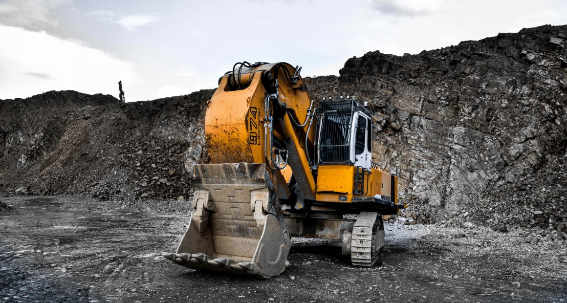 Yellow Excavator in a mine