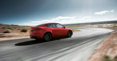 Red Tesla Model Y on Race Track