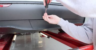 Model Y Trailer Hitch Panel being removed